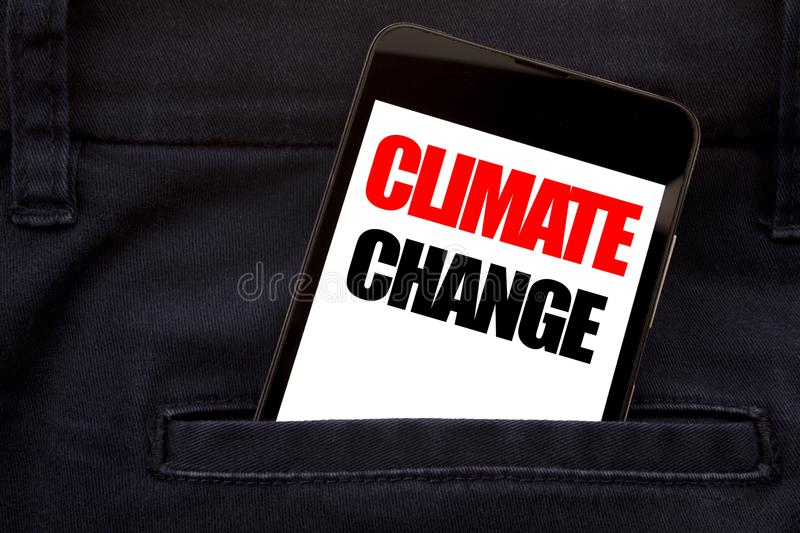 Word, writing Climate Change. Business concept for Global Planet Warming Written phone mobile phone, cellphone placed in the man f stock photo