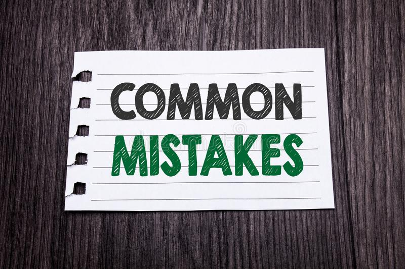 Word, writing Common Mistakes. Business concept for Common Concept written on sticky note paper on the dark wooden background. Bla. Word, writing Common Mistakes stock image