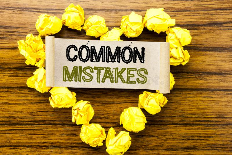 Word, writing Common Mistakes. Business concept for Common Concept written on sticky note paper on the dark wooden background. Wit. Word, writing Common Mistakes royalty free stock photos