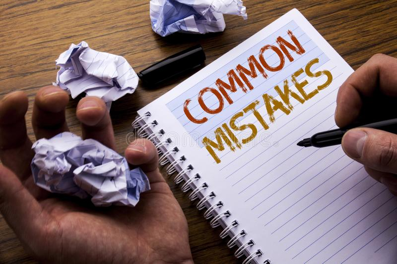 Word, writing Common Mistakes. Concept for Common Concept written on notebook notepad note paper on the wooden background with fol. Word, writing Common Mistakes stock image