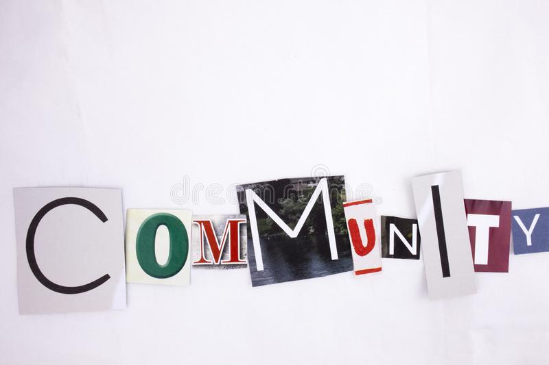 A word writing COMMUNITY made of different magazine newspaper letter magazine different letters for Business concept. A word writing COMMUNITY made of different royalty free stock photo
