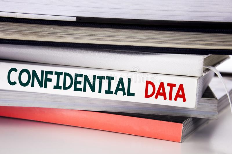 Word, writing Confidential Data. Business concept for Secret Protection written on the book on the white background. Word, writing Confidential Data. Business stock photos