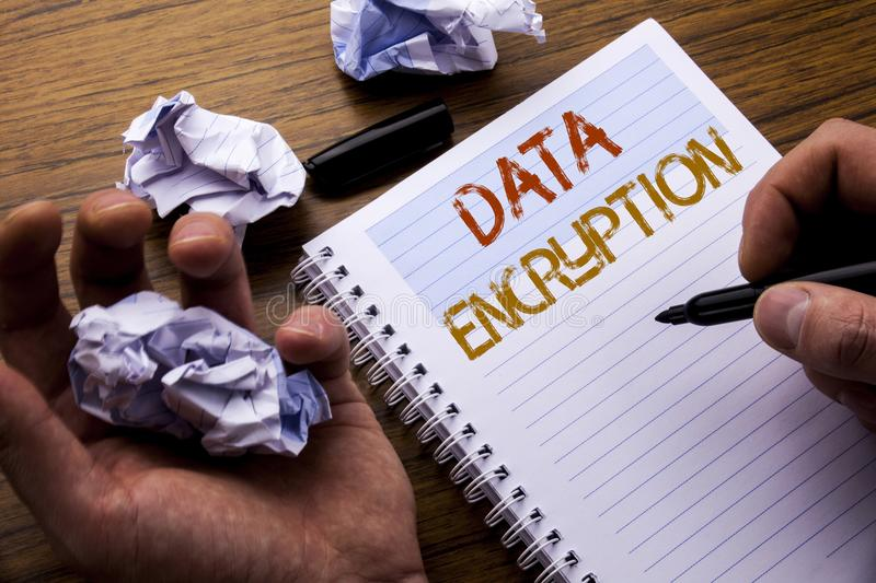 Word, writing Data Encryption. Concept for Information Security written on notebook notepad note paper on the wooden background wi. Word, writing Data Encryption stock photography