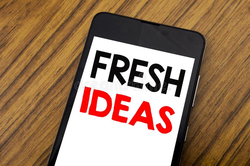 Word, writing handwriting Fresh Ideas. Business concept for Thinking Inspiration Inspire Creativity Written on mobile phone cellph royalty free stock photos