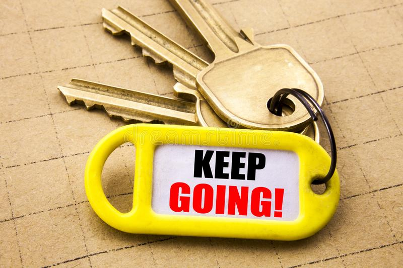 Word, writing Keep Going. Business concept for Go Moving Forward Letting Written on key holder, textured background close up. Word, writing Keep Going. Business stock images