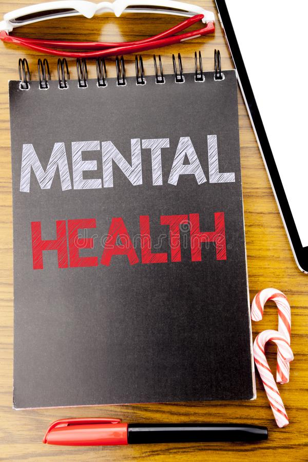Word, writing Mental Health. Business concept for Anxiety Illness Disorder Written on the notebook book, wooden background with st. Word, writing Mental Health royalty free stock photography