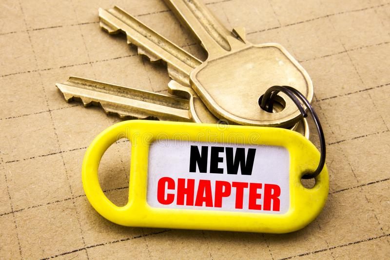 Word, writing New Chapter. Business concept for Starting New Future Life Written on key holder, textured background close up. Word, writing New Chapter royalty free stock images