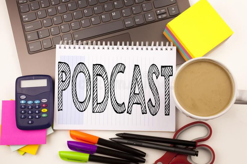 Word writing Podcast in the office with laptop, marker, pen, stationery, coffee. Business concept for Internet Broadcasting Concep stock photography