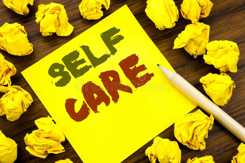 Word, writing Self Care. Business concept for Taking caring for own Health Written on sticky note paper, wooden background with fo. Word, writing Self Care stock images