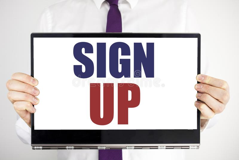 Word, writing Sign Up. Business concept for Member Register Registration Written on tablet laptop holding by the man blurred backg. Word, writing Sign Up royalty free stock image