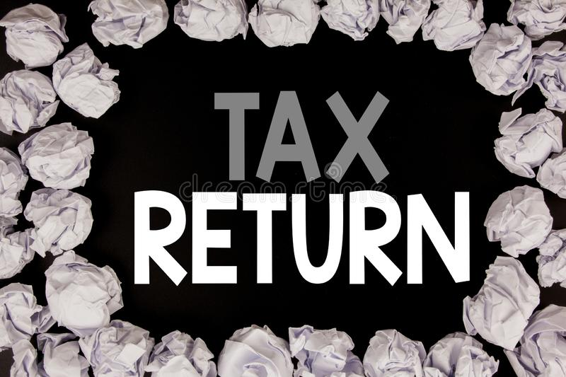 Word, writing Tax Return. Business concept for Accounting Money Return written on black background with copy space on old backgrou. Word, writing Tax Return royalty free stock photos