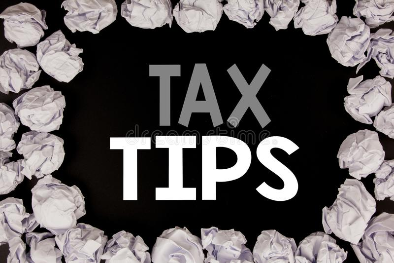 Word, writing Tax Tips. Business concept for Taxpayer Assistance Refund Reimbursement written on black background with copy space. On background with folded royalty free stock photos