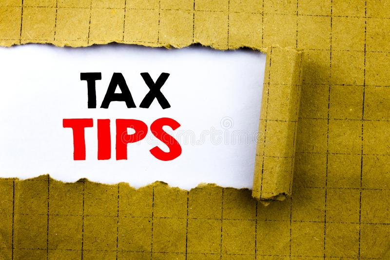 Word, writing Tax Tips. Business concept for Taxpayer Assistance Refund Reimbursement written on white paper on the yellow folded. Word, writing Tax Tips royalty free stock photos