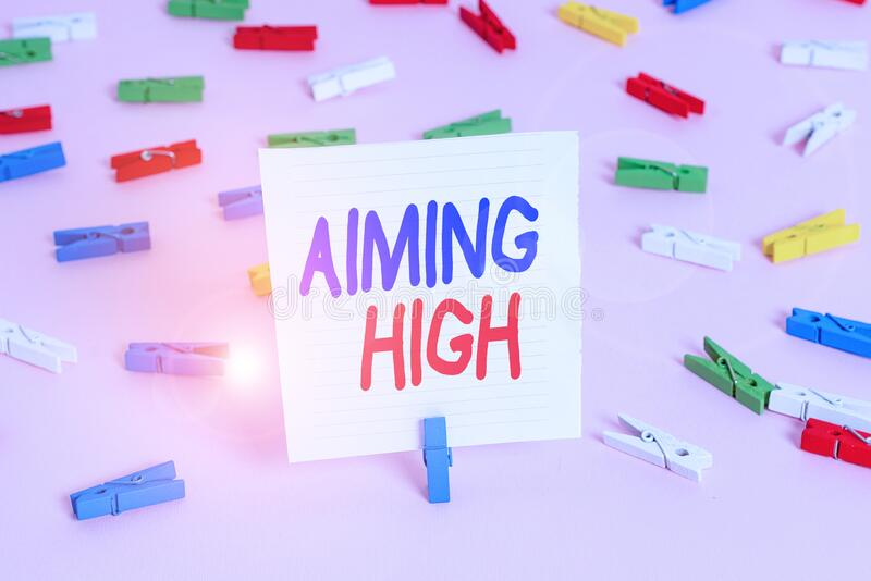 Word writing text Aiming High. Business concept for a result that your plans or actions are intended to achieve Colored clothespin. Word writing text Aiming High royalty free stock image