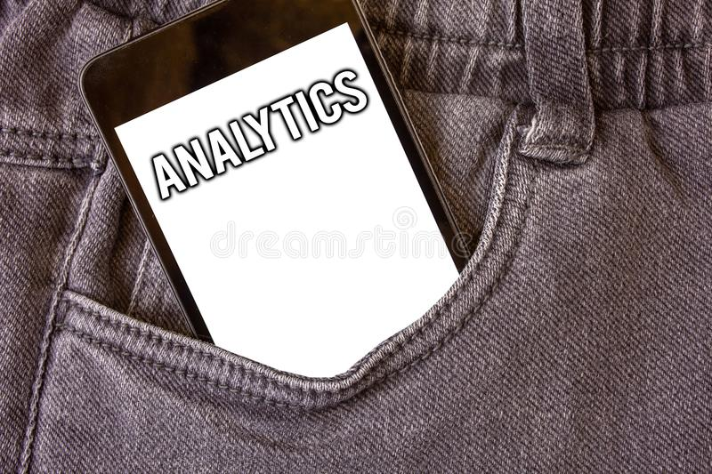 Word writing text Analytics. Business concept for Data Analysis Financial Information Statistics Report Dashboard Cell phone jean. Pocket white screen message stock photography