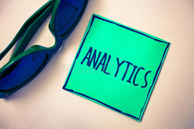 Word writing text Analytics. Business concept for Data Analysis Financial Information Statistics Report Dashboard Green paper beig. E background sunglasses ideas royalty free stock images
