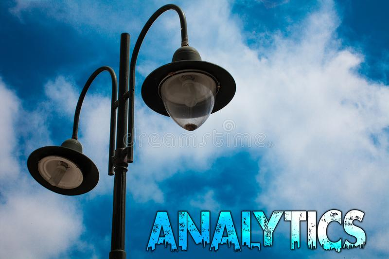 Word writing text Analytics. Business concept for Data Analysis Financial Information Statistics Report Dashboard Light post blue. Cloudy clouds sky ideas royalty free stock photos