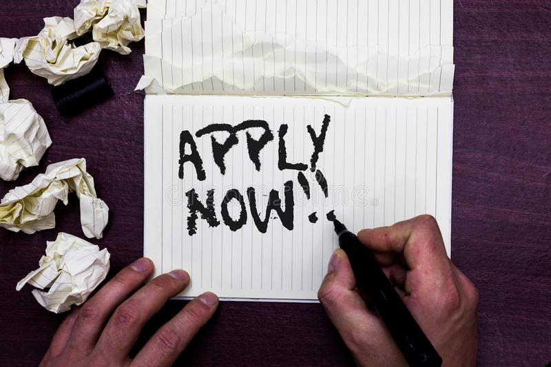 Word writing text Apply Now. Business concept for Make a formal application for a job right away Take action Man holding marker no. Tebook page crumpled papers stock photos