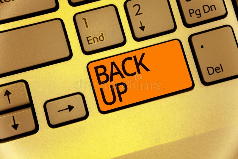 Word writing text Back Up. Business concept for saving important data into internet cloud and restore them later Keyboard orange k royalty free stock images