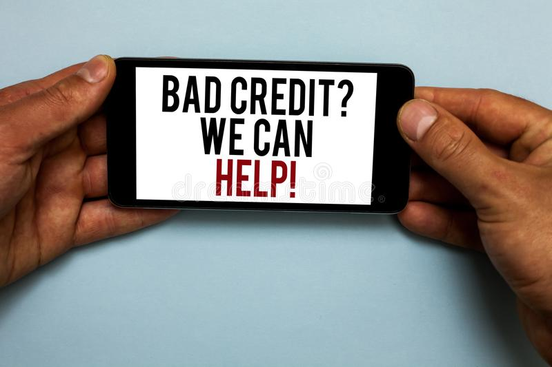 Word writing text Bad Credit question We Can Help. Business concept for Borrower with high risk Debts Financial Human hand hold sm. Artphone with red and black stock image