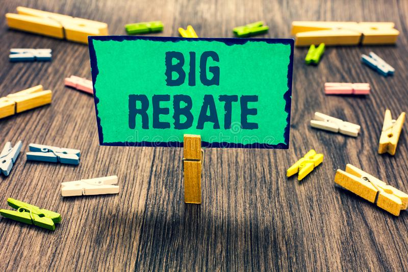 Word writing text Big Rebate. Business concept for Huge rewards that can get when you engaged to a special promo Clothespin holdin. G green paper note several stock images