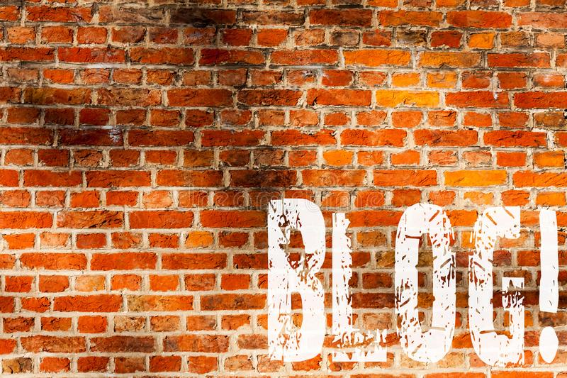 Word writing text Blog. Business concept for Preperation of catchy content for blogging websites Brick Wall art like Graffiti. Motivational call written on the royalty free stock image