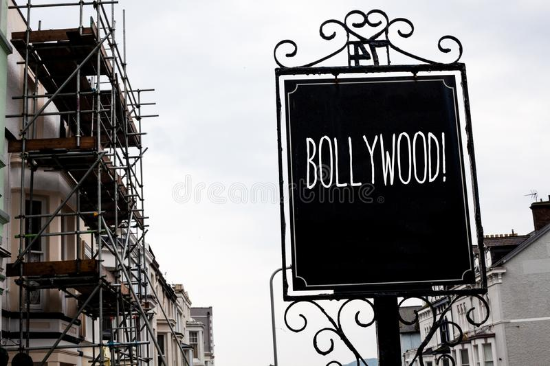 Word writing text Bollywood Motivational Call. Business concept for Hollywood Movie Film Entertainment Cinema Vintage black board. Sky old city vintage antique stock image