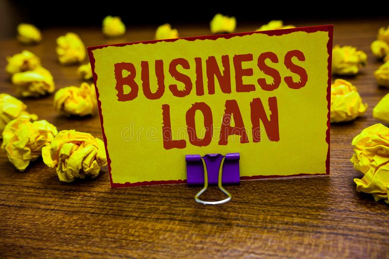 Word writing text Business Loan. Business concept for Credit Mortgage Financial Assistance Cash Advances Debt Clip holding yellow. Paper note crumpled papers royalty free stock photo