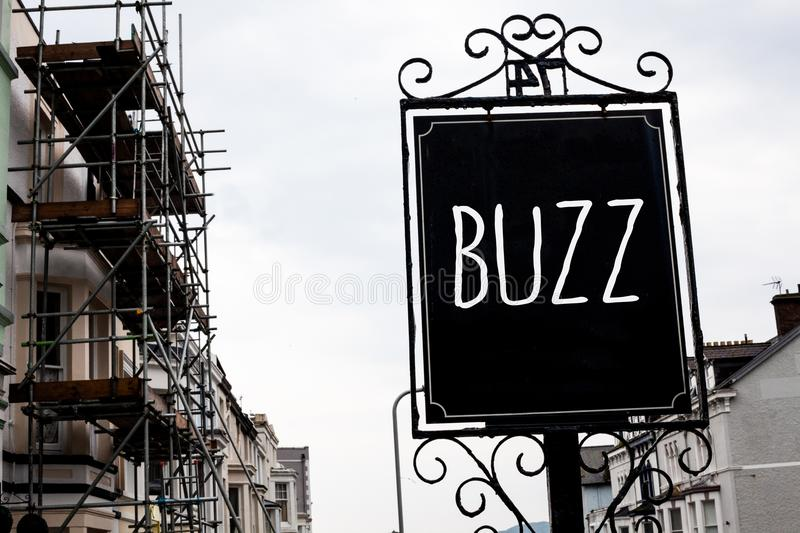 Word writing text Buzz. Business concept for Hum Murmur Drone Fizz Ring Sibilation Whir Alarm Beep Chime Vintage black board sky o stock photo