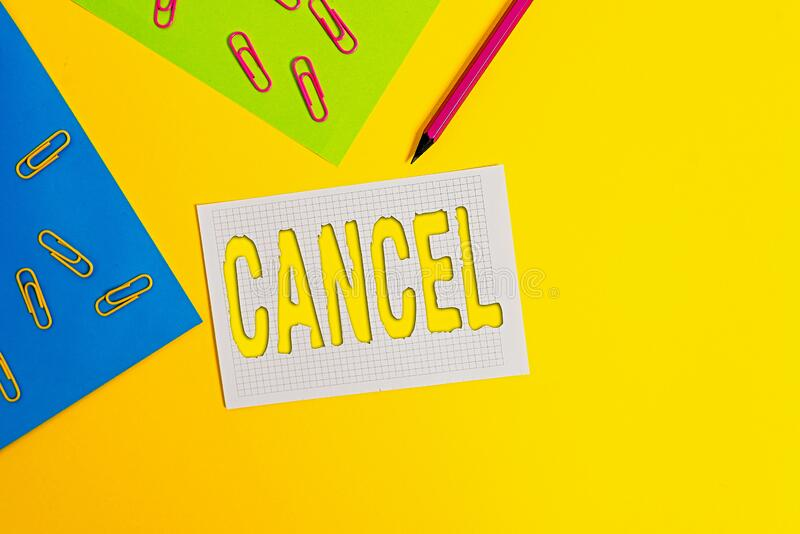 Word writing text Cancel. Business concept for To decide or announce that planned event will not take place Blank paper sheets. Word writing text Cancel royalty free stock photography