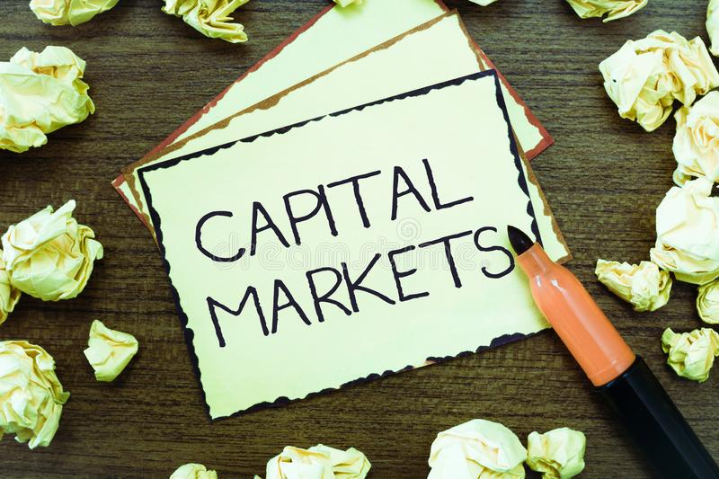Word writing text Capital Markets. Business concept for Allow businesses to raise funds by providing market security.  stock photos