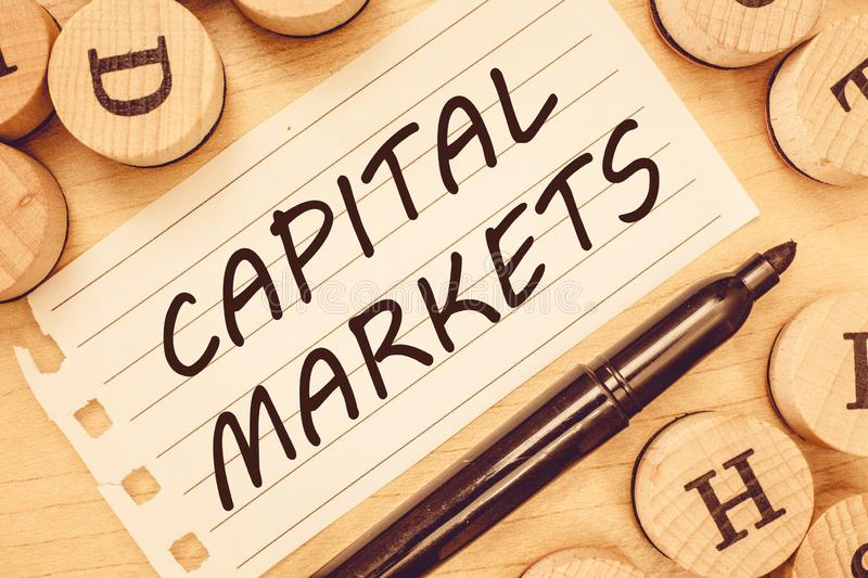 Word writing text Capital Markets. Business concept for Allow businesses to raise funds by providing market security.  royalty free stock photos