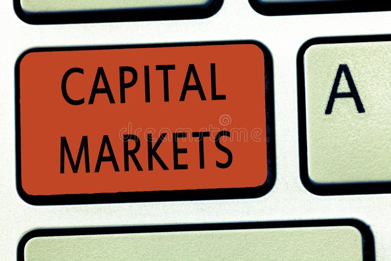 Word writing text Capital Markets. Business concept for Allow businesses to raise funds by providing market security.  stock photography