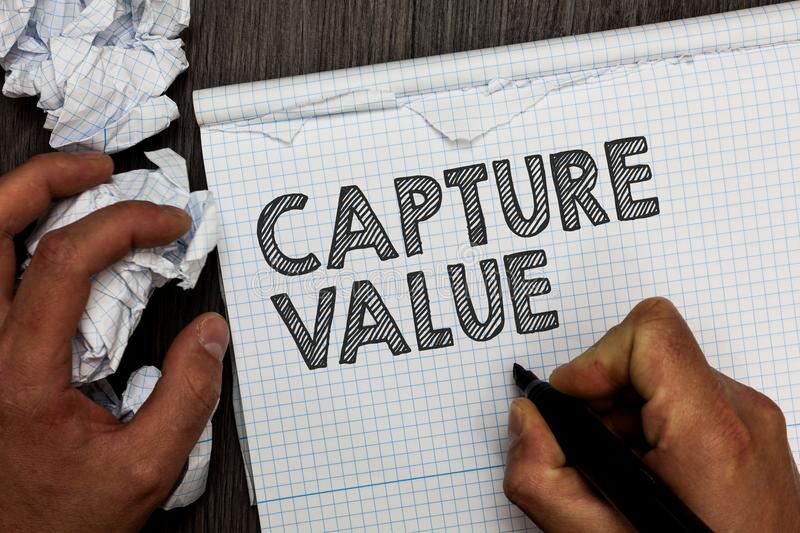 Word writing text Capture Value. Business concept for Customer Relationship Satisfy Needs Brand Strength Retention Man holding mar royalty free stock photography
