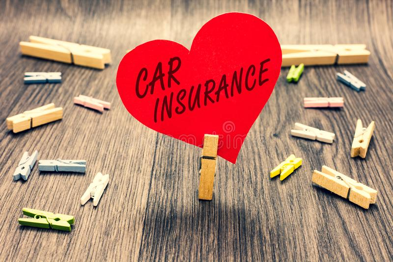 Word writing text Car Insurance. Business concept for Accidents coverage Comprehensive Policy Motor Vehicle Guaranty Clothespin ho. Lding red paper heart several royalty free stock photo