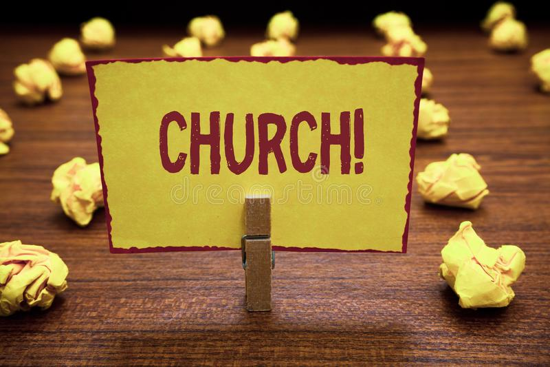 Word writing text Church. Business concept for Building used for public Christian worship Religious spiritual place. Clothespin holding yellow paper note stock photos