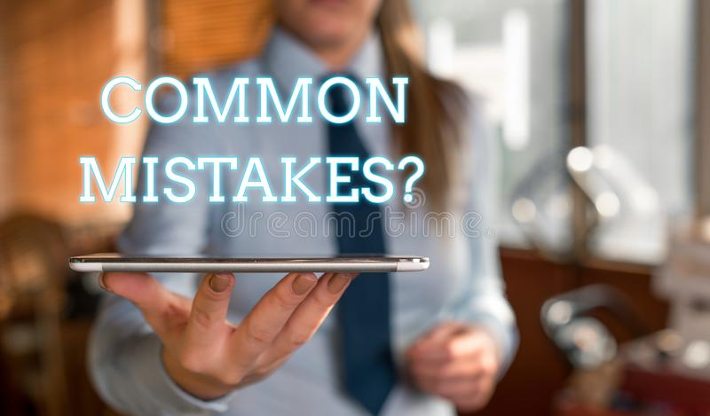 Word writing text Common Mistakes question. Business concept for repeat act or judgement misguided or wrong Blurred. Word writing text Common Mistakes question royalty free stock photography