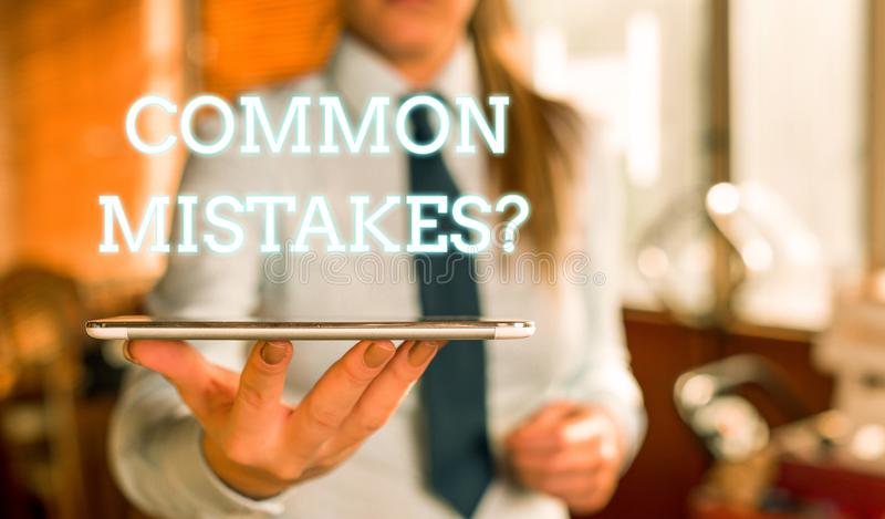 Word writing text Common Mistakes question. Business concept for repeat act or judgement misguided or wrong Blurred. Word writing text Common Mistakes question stock images