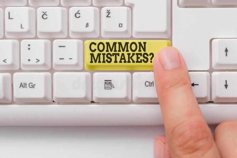 Word writing text Common Mistakes question. Business concept for repeat act or judgement misguided or wrong White pc. Word writing text Common Mistakes question royalty free stock photography