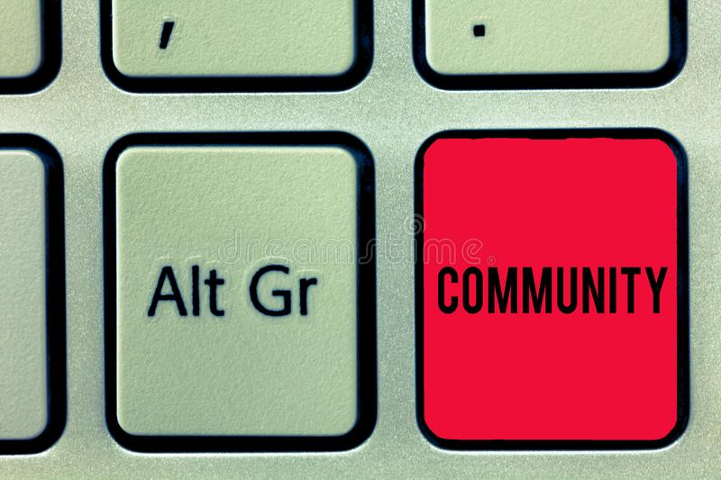 Word writing text Community. Business concept for group living in same place or having characteristic in common Keyboard. Key Intention to create computer royalty free stock photography