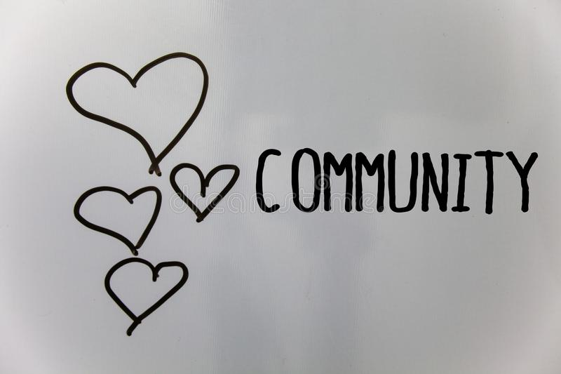 Word writing text Community. Business concept for Neighborhood Association State Affiliation Alliance Unity Group Hearts white bac. Kground ideas messages love stock photography