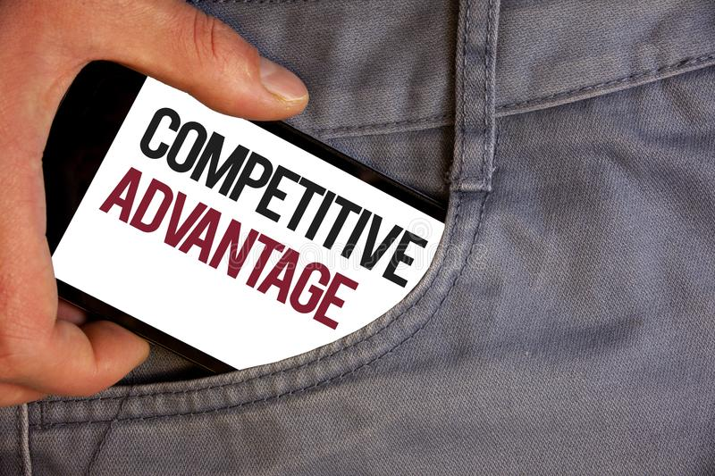 Word writing text Competitive Advantage. Business concept for owning quality that will assure you leading in field Personage hand. Pushing mobile phone into stock photography