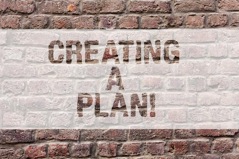 Word writing text Creating A Plan. Business concept for Establish steps to follow for a project strategy to succeed. Brick Wall art like Graffiti motivational royalty free stock photos