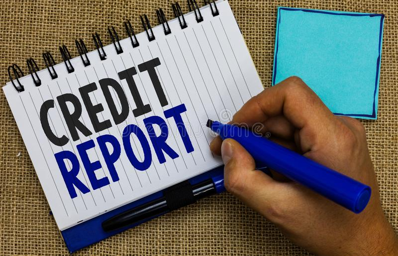 Word writing text Credit Report. Business concept for Borrowing Rap Sheet Bill and Dues Payment Score Debt History Man holding mar. Ker notebook page reminder royalty free stock images