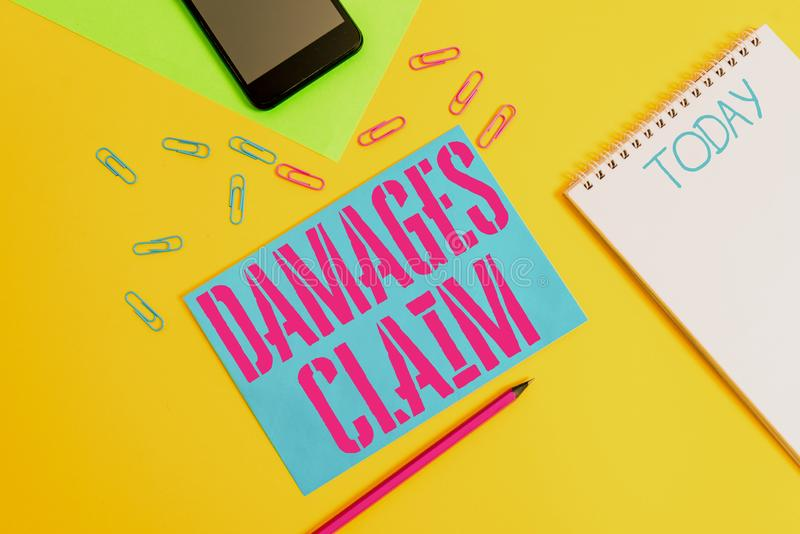 Word writing text Damages Claim. Business concept for Deanalysisd Compensation Litigate Insurance File Suit Blank spiral. Word writing text Damages Claim royalty free stock images