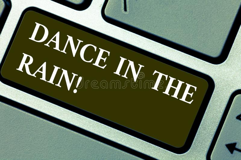 Word writing text Dance In The Rain. Business concept for Enjoy the rainy day childish activities happy dancing Keyboard stock images