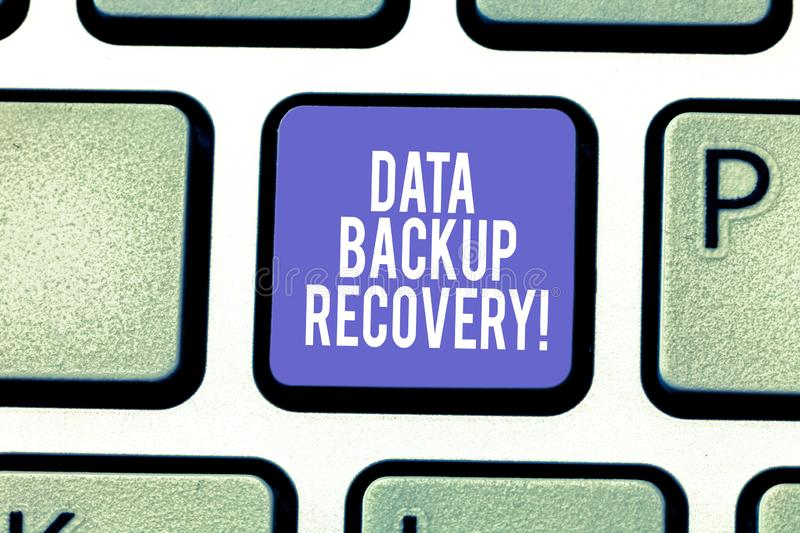 Word writing text Data Backup Recovery. Business concept for the process of backing up data in case of a loss Keyboard. Key Intention to create computer message stock photos