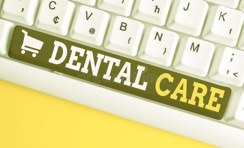 Word writing text Dental Care. Business concept for maintenance of healthy teeth or to keep it clean for future White pc. Word writing text Dental Care. Business stock photos