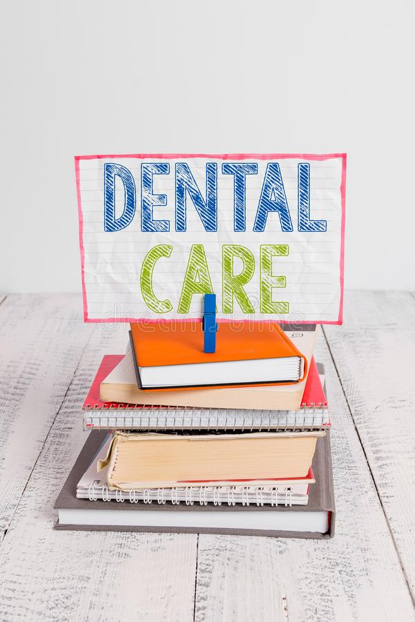 Word writing text Dental Care. Business concept for maintenance of healthy teeth or to keep it clean for future pile. Word writing text Dental Care. Business royalty free stock photography