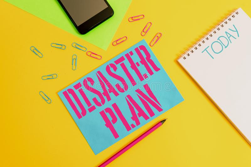 Word writing text Disaster Plan. Business concept for Respond to Emergency Preparedness Survival and First Aid Kit Blank spiral. Word writing text Disaster Plan stock image